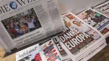 Les journaux allemands, ce lundi matin. Crédits photo : JOHN MACDOUGALL/AFP
