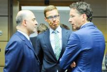 Pierre Moscovici (gauche), Alexander Stubb (centre) et Jeroen Dijsselbloem. © EPA