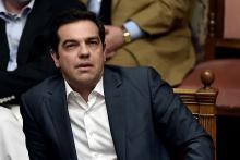 Greek Prime Minister Alexis Tsipras attends a parliament session in Athens on July 15, 2015. AFP PHOTO / ARIS MESSINIS - AFP/Aris Messinis