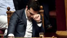 Alexis Tsipras pendant la séance de l'Assemblée à Athènes, mercredi. Crédits photo : ARIS MESSINIS/AFP