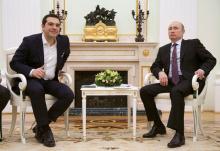 Le premier ministre grec Alexis Tsipras et le président russe Vladimir Poutine se sont rencontré hier à Moscou pour mettre en route des projets de coopération.La Grèce n'a cependant pas demandé d'aide financière à la Russie. Image: ALEXANDER ZEMLIANICHENKO/AFP