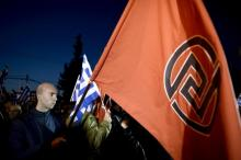 Des supporteurs du parti néonazi Aube Dorée, en mars 2015. (Photo Aris Messinis. AFP)