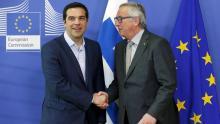 Le premier ministre grec Alexis Tsipras et le président de la commission européenne Jean-Claude Juncker. Crédits photo : FRANCOIS LENOIR/REUTERS