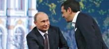 Vladimir Poutine et Alexis Tsipras au Forum économique international de Saint-Pétersbourg vendredi. Le leader grec a dénoncé «le cercle vicieux des sanctions» et mollement soutenu les accords de paix de Minsk. Crédits photo : GRIGORY DUKOR/REUTERS