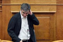 Le ministre des Finances grec Euclide Tsakalotos soutenait le vote du plan de réformes devant le Parlement, jeudi à Athènes, et retrouvera ses collègues de l'Eurogroupe, vendredi après-midi à Bruxelles - Louisa Gouliamaki/AFP