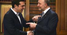 Le Premier ministre grec, Alexis Tsipras, avec Pierre Moscovici, commissaire européen. - Photo Louisa Gouiliamaki / AFP