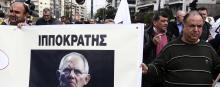 Une manifestation à Athènes mercredi 15 mars, qui condamne l'austérité du ministre des finances allemandWolfgang Schaeuble. / AP © Yorgos Karahalis