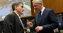 Euclide Tsakalotos, le ministre des Finances grec, et son homologue français, Bruno Le Maire, au Luxembourg. - Photo J.Thys/AFP